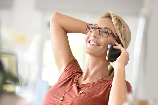 woman on phone with best baltimore plastic surgeon
